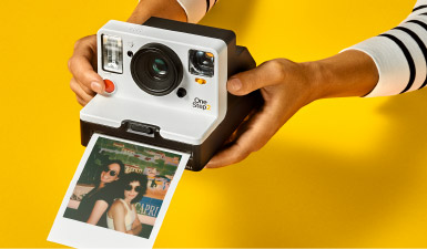 Taking a picture with a Polaroid camera