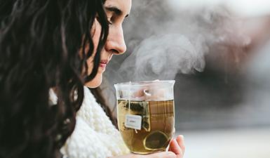 A woman enjoying her tea.